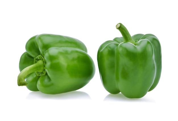 Зеленый перец на белом.