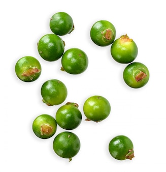 Green peppercorn isolated on white top view