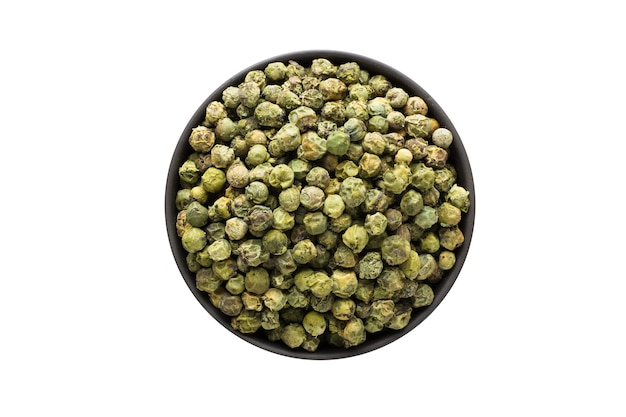 Green peppercorn seeds in clay bowl isolated on white background