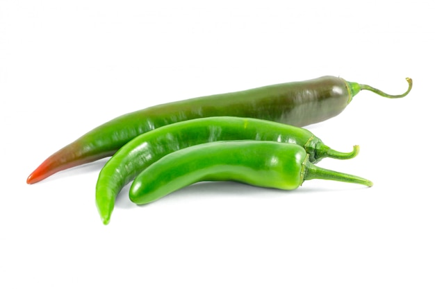 Green peppers isolated on a white surface