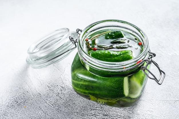 Green pickle cucumbers in a glass jar