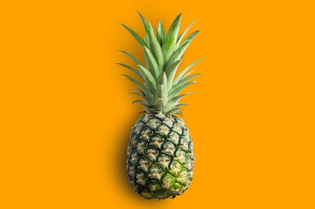 Green pineapple  isolated with clipping paths on orange color background