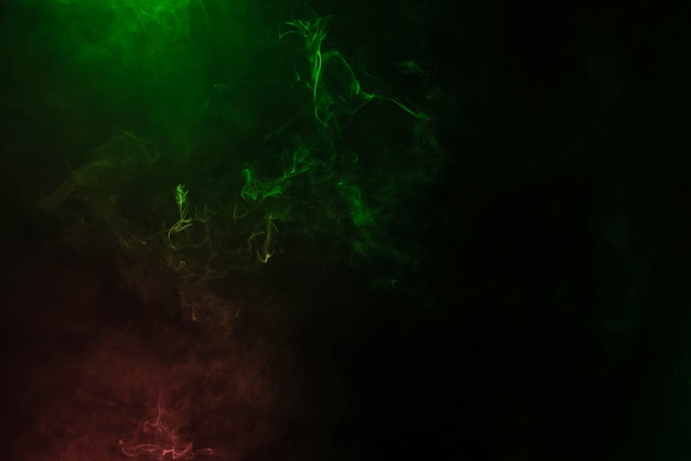 Green and pink steam on a black surface
