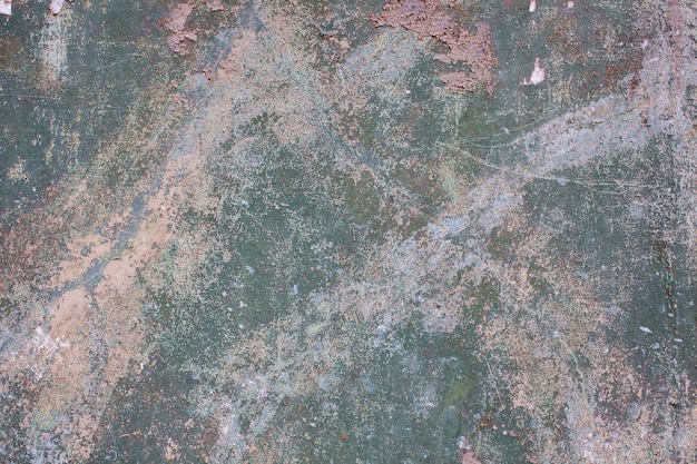 Green-pink wall with cracked paint