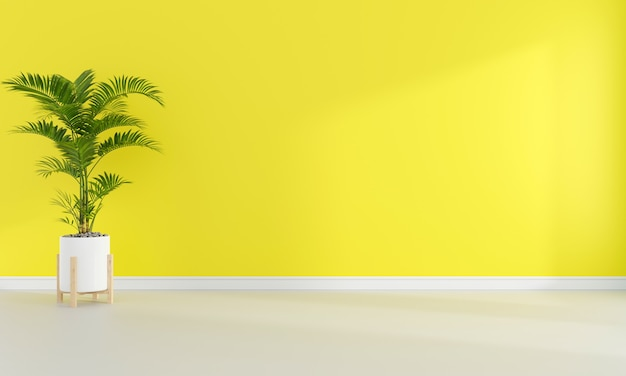 Зеленое растение в желтой гостиной со свободным пространством