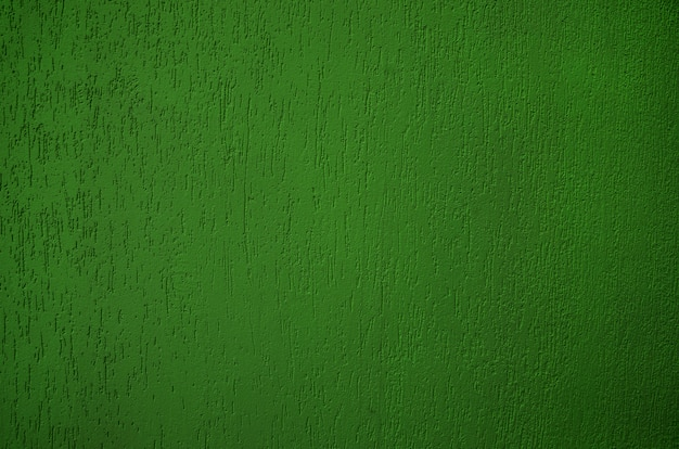 Зеленая оштукатуренная стена как фон
