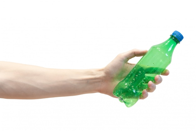 Green plastic bottle in men's hand. human's arm gives a plastic bottle