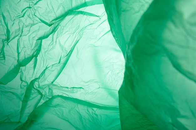 Green plastic garbage bag material as a background