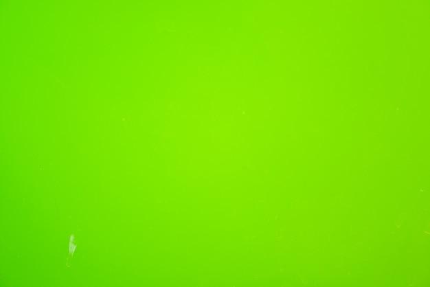 緑のプラスチック素材の背景、抽象的なテクスチャ。