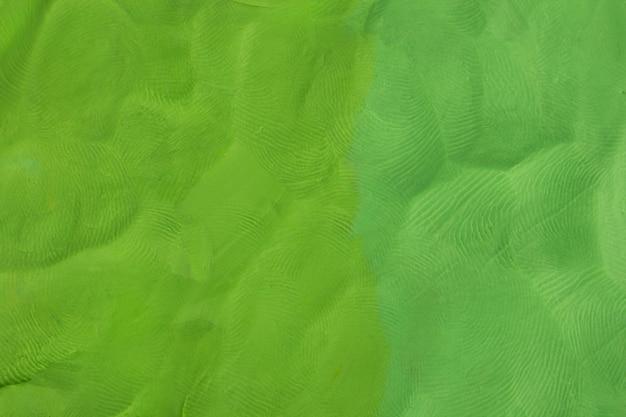 Green plasticine textured background