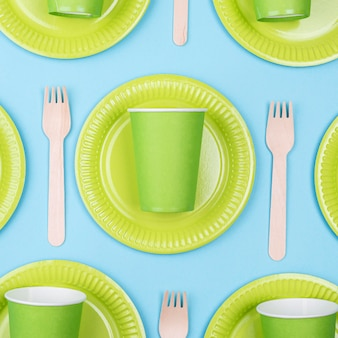 Green plates with cups and cutlery