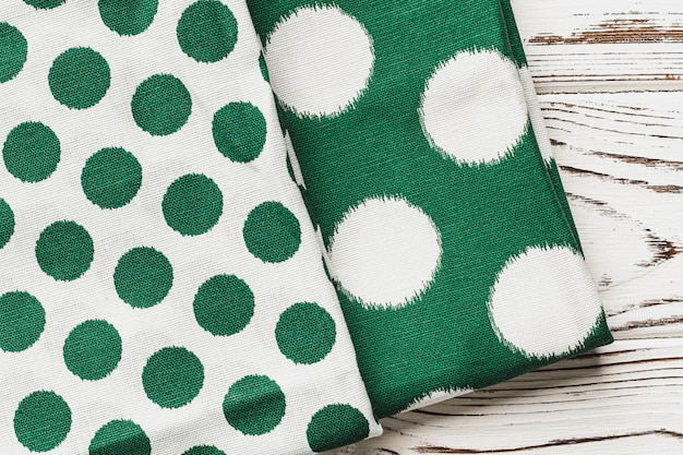 Green polka dot napkin on weathered wooden table