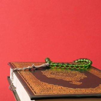 Green prayer beads on quran