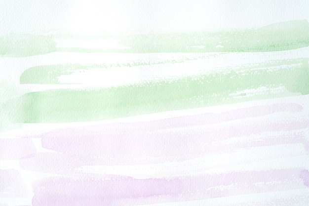 Green and purple watercolor texture on white paper background