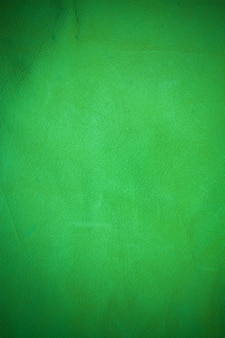 Green real leather background.