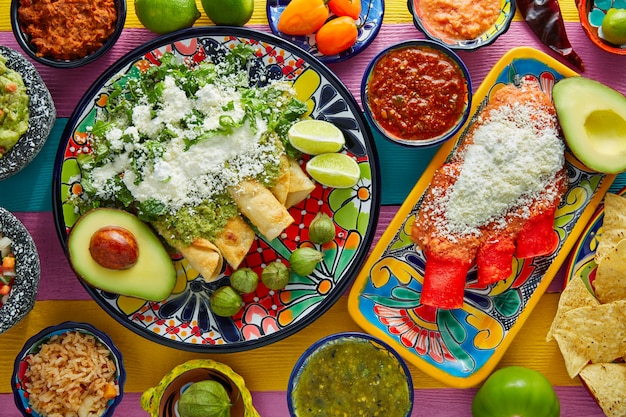 Green and red enchiladas with mexican sauces