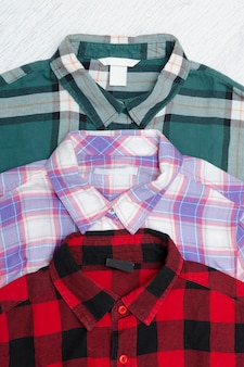 Green, red and lavender plaid shirts. fashionable concept