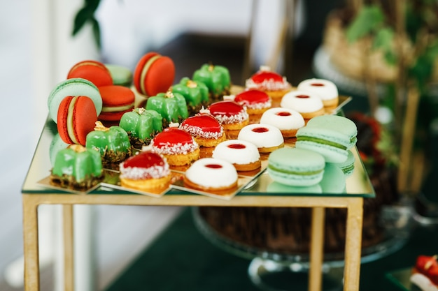 Green and red sweets served on box on candy-bar