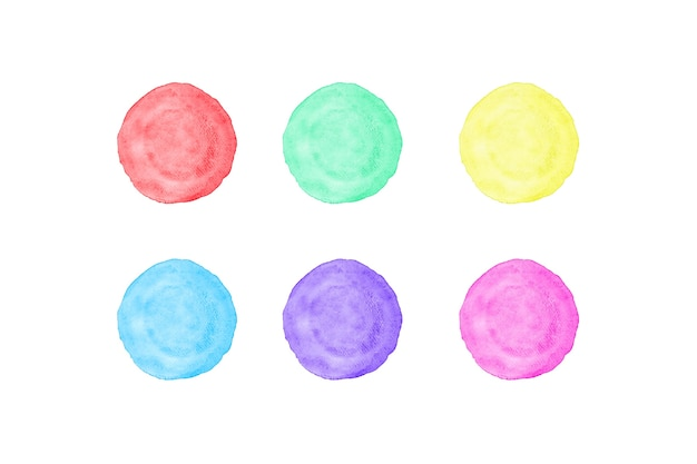 Green, red, yellow, purple, blue and pink circle watercolor painting textured on white paper.