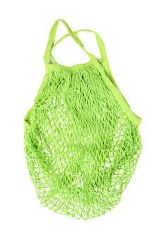 Green reusable string bag woven from thread isolated on white background, zero waste