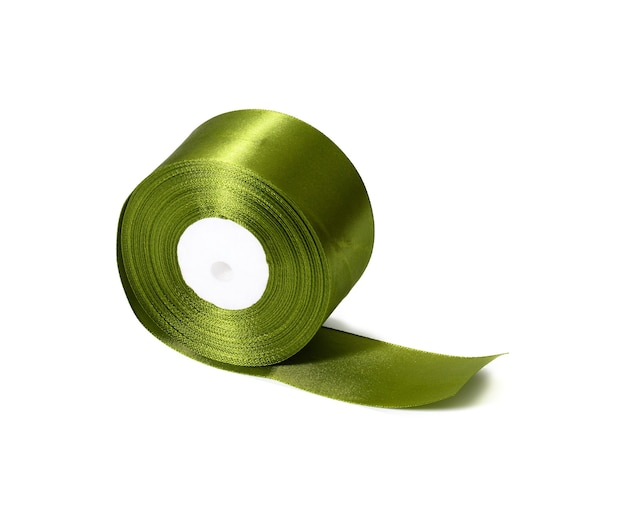 Green roll of silk green ribbon, wrapping decor, white isolated background
