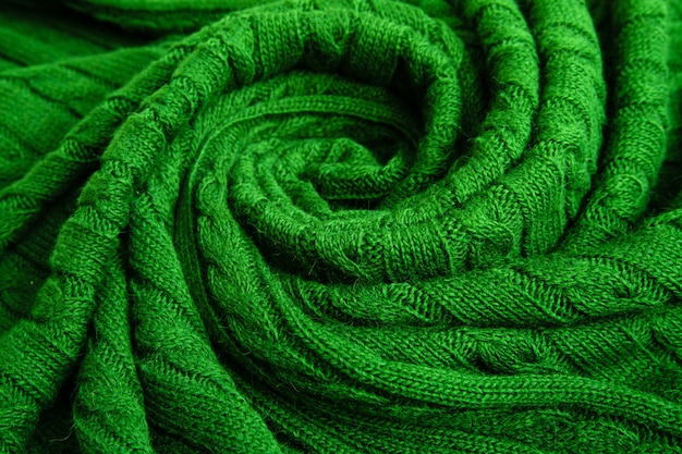 Green rolled-up plaid, knitted pigtail