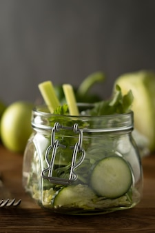Green salad packed in mason jar. healthy, homemade, take away food. copy space.