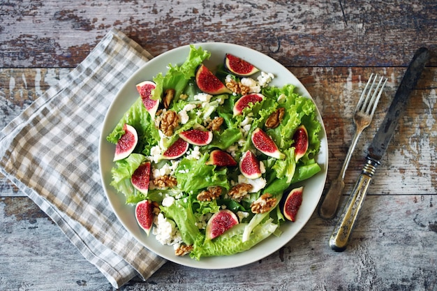 Green salad with figs and white cheese. keto salad. keto diet.