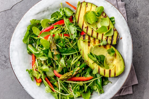Green salad with grilled avocado