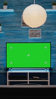 Green screen design on television in empty room