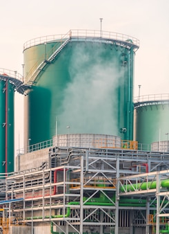 Green service water tank and pipeline at power plant in thailand. Premium Photo