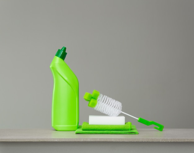 Green set of cleaning products and tools for spring cleaning.