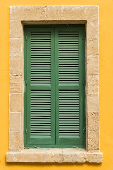Green  the shutters of the window