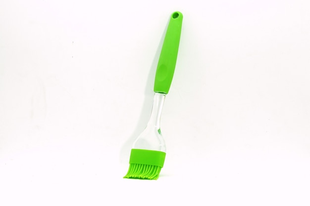 Green silicone brush for cooking on isolated white background