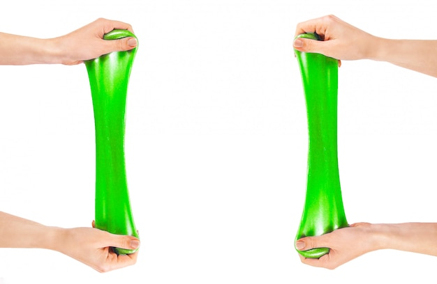 Green slime. an elastic antistress toy. gum for hands.