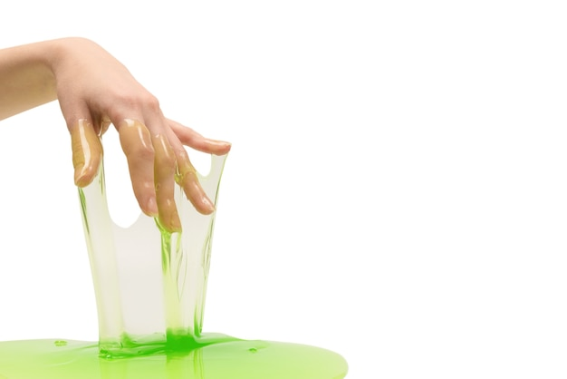 Green slime toy in woman hand isolated on white.