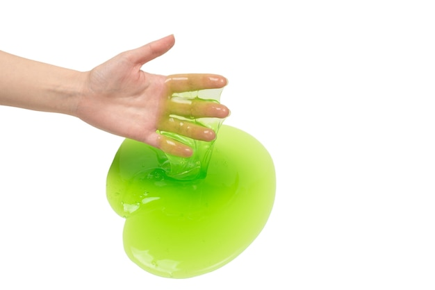 Green slime toy in woman hand isolated on white
