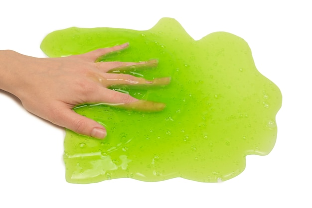 Green slime toy in woman hand