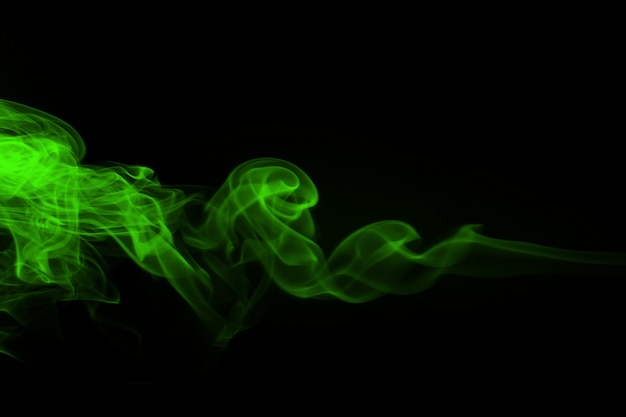 Green smoke abstract on black and darkness concept
