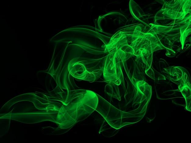 黒背景、闇の概念に緑の煙の要約