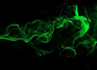 黒の背景と闇のコンセプトの緑の煙の抄録
