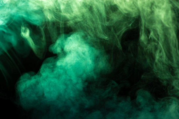 Green smoke on black - abstract background