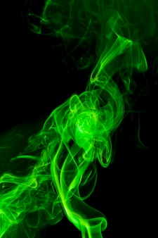 Green smoke on black background