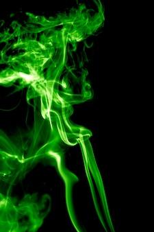 Green smoke on black background Premium Photo