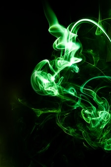 Green smoke motion on black background.
