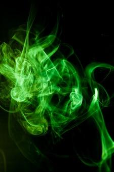 Green smoke motion on black background.