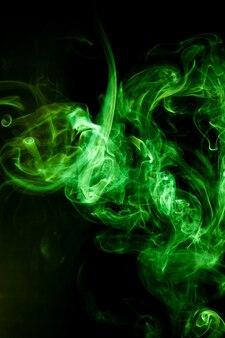 Green smoke motion on black.