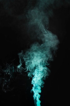 Green smoke movement on dark background