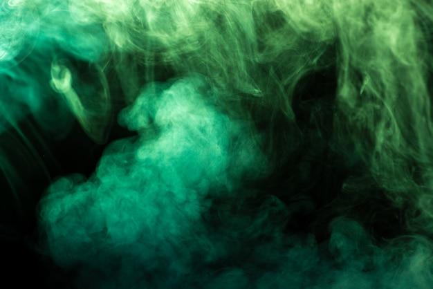 黒-抽象的な背景に緑の煙