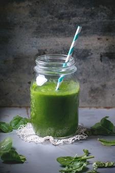 Green smoothie on concrete